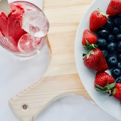 delicious tasty appetizing hand made ice cream with fruits with strawberry blueberry and ice, flatlay close up lifestyle