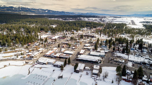 High elevation overhead view of McCall Idaho with mountains and snow on the ground