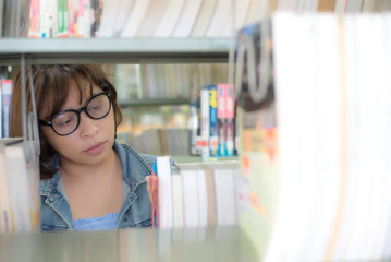 Asian student women finding book for reading in library.  Education  Concept
