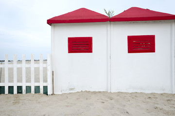 red and white beach cabins