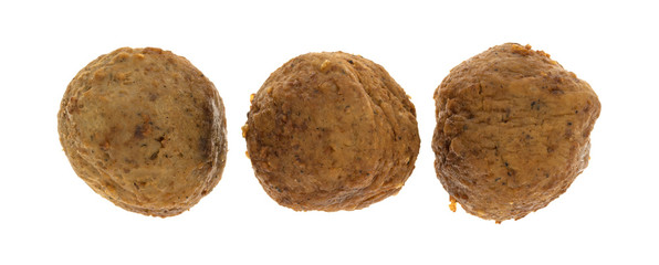 Three meatballs in a row isolated on a white background.