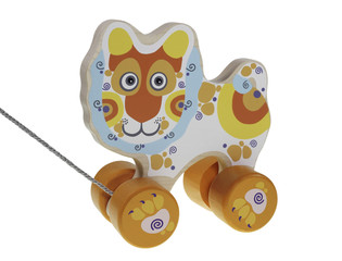 Wooden colored children's walk-a-long lion on a white background