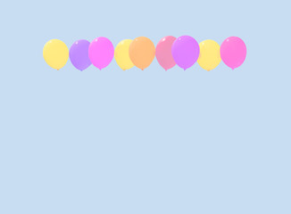 Colourful faded balloons yellow pink purple red soaring against light blue sky with copy space.