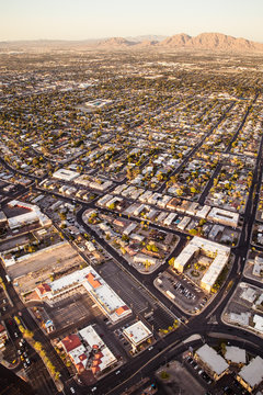 Aerial view across urban suburban communities seen from Las Vegas Nevada with streets, rooftops, and homes