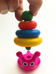 Picture of a baby toy snail-pyramid on a white background
