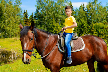 child is riding horse