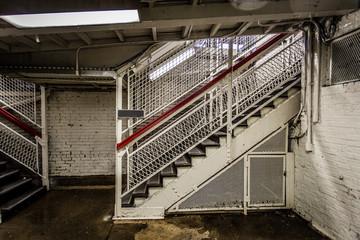 Dank stairwell leading to train platform