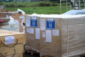 WHO medical supplies to combat the Ebola virus are seen packed in crates at the airport in Mbandaka