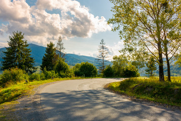 old serpentine road in to the mountains. beautiful nature scenery in mountainous area. lovely transportation background.