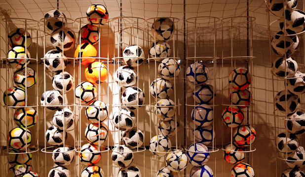 Various soccer balls are on display in a sports store in Innsbruck