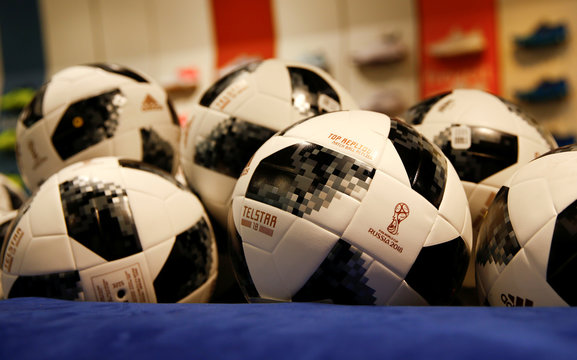 Replicas of the official 2018 Fifa World Cup Russia ball are on display in a sports store in Innsbruck