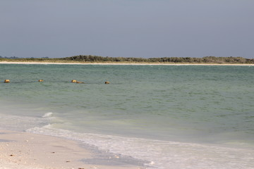 Beach shoreline of an island with anothe island in the background