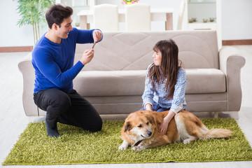 Happy family with golden retriever dog