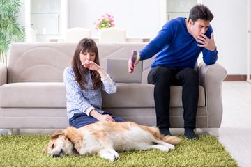 Man having allergy from dog fur