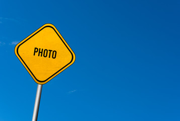 photo - yellow sign with blue sky