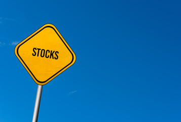 stocks - yellow sign with blue sky