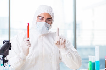 Male chemist working in lab