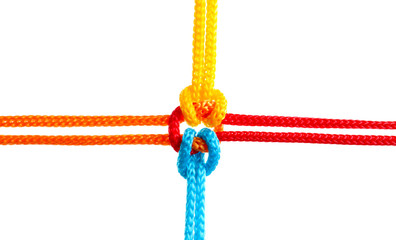 Colorful ropes tied together on white background. Unity concept Wall mural