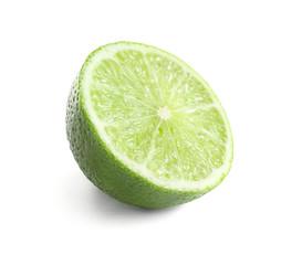 Half of fresh ripe lime on white background