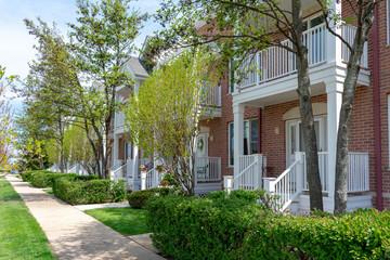 Row of charming brick townhomes in suburban neighborhood