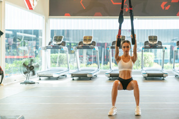 young fitness woman executed exercise with exercise-machine