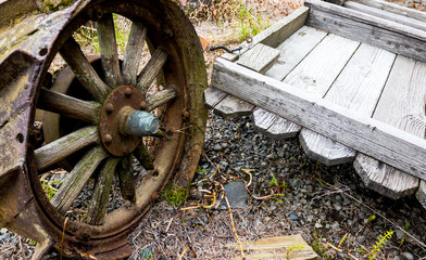 Vintage antique automotive tractor wheel covered in rust