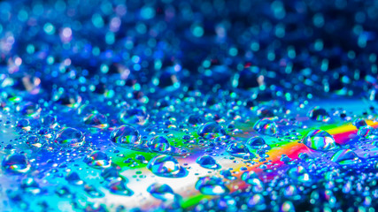 Water drops on the DVD, abstract view, selective focus, low light, underexposed, blur. Best for wallpaper and background use.