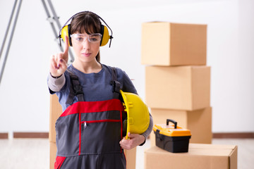 Woman contractor worker with noise cancelling headphones