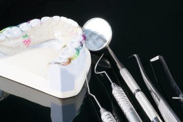 Dental  retainer orthodontic appliance on the white background.