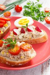 Mackerel or tuna fish paste sandwiches on glass plate