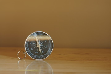 Compass on blur photograph of popular toustist destination background, China traveling concept