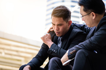 Two asian Businessman feel sad and frustrated upset fail in life.