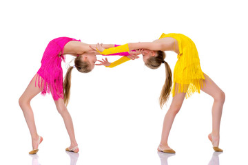 Girls gymnasts perform exercises.