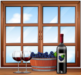 Red Wine in glasses with a barrell of grapes background