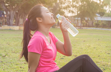 Women exercise with drinking water
