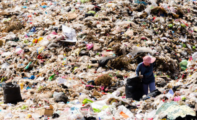 MUKDAHAN PROVINCE, THAILAND-FEBRUARY 29: People working in Municipal waste disposal open dump process.  Dump site at Mukdahan Province on FEBRUARY 29 , 2016 in MUKDAHAN PROVINCE THAILAND