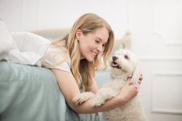 Smiling girl hugging her dog
