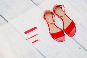 Red sandals on legs Wall mural