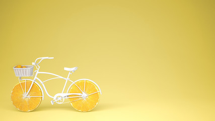 White bike with sliced orange wheels, healthy lifestyle concept with yellow pastel background copy space