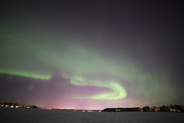 north light aurora on night sky at swedish countryside, north of country, winter lake