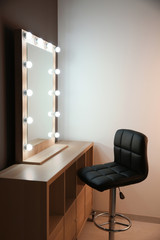 Workplace of professional makeup artist with large mirror