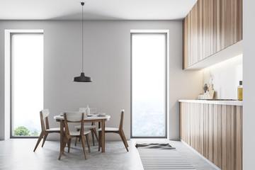 Wooden loft kitchen interior, round table