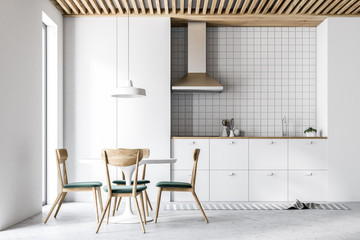Interior of modern white kitchen, chairs and table