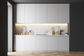 White and black counterops in kitchen