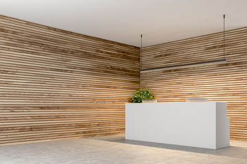White reception in a wooden wall office corner
