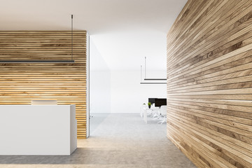 White reception counter in a wooden wall office
