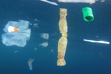 Plastic bottles and bags pollution in ocean environment