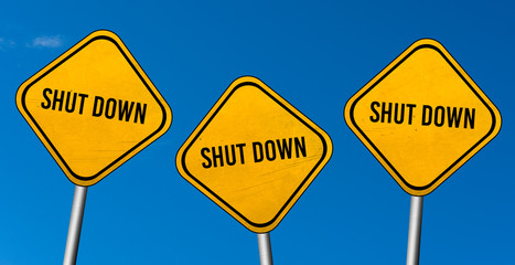shut down - yellow sign with blue sky