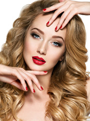 Pretty woman with long  hair and red nails