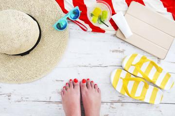 Beach accessories on white wooden background
